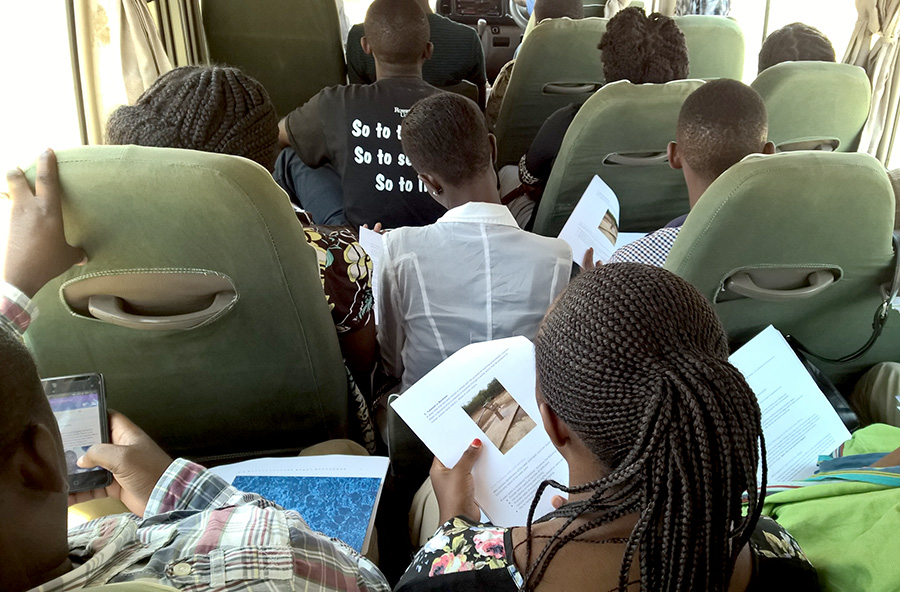 Enumerators reading the manuals on the way to do the pilot exercise: